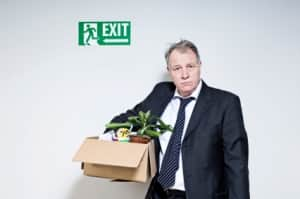 man packing up after losing job