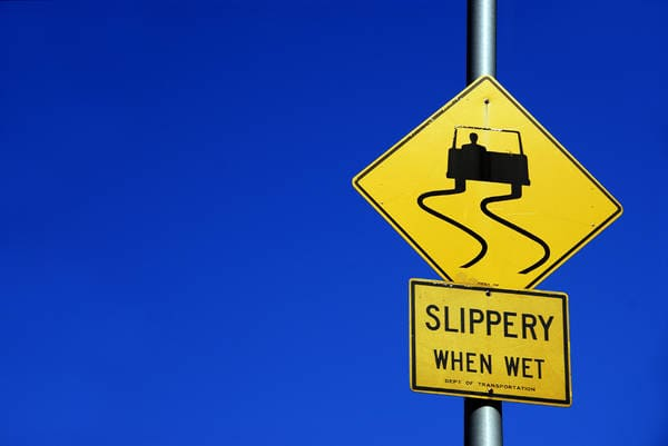 Slippery when wet sign (Photo: iStockPhoto)