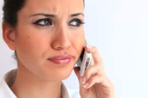 woman annoyed by phone calls from health insurer