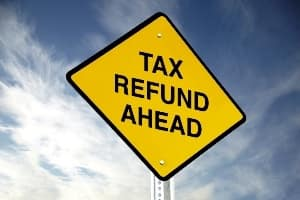 Tax Refund written on road sign
