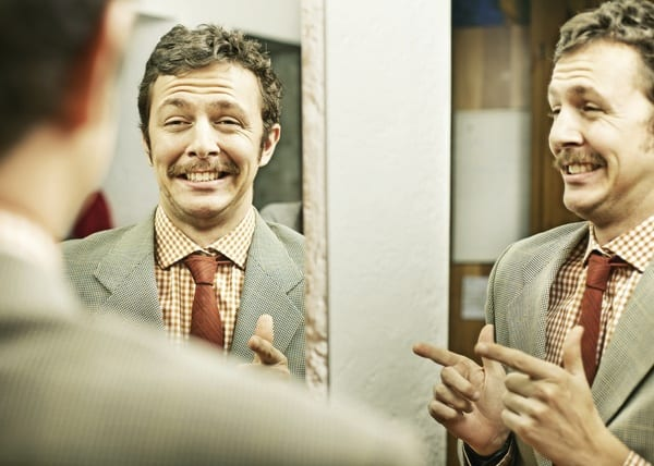 Overconfident man smiling in mirror