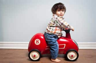 Toddler in toy car