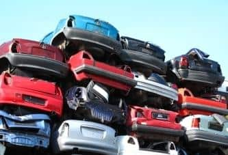 Cars stacked in salvage yard