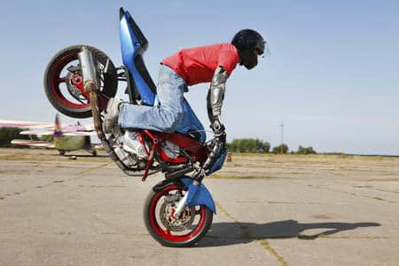 Motorcyclists doing stoppie (Photo: iStockPhoto)