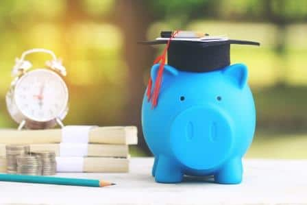 piggy bank with grad hat