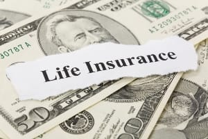 Life insurance on stack of money