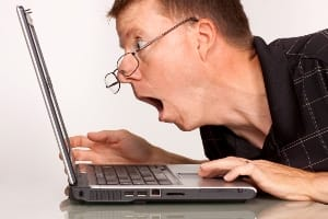surprised man looking at computer