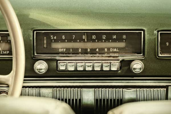 The first car radio appeared in 1922; they were ubiquitous by the 1950s.
